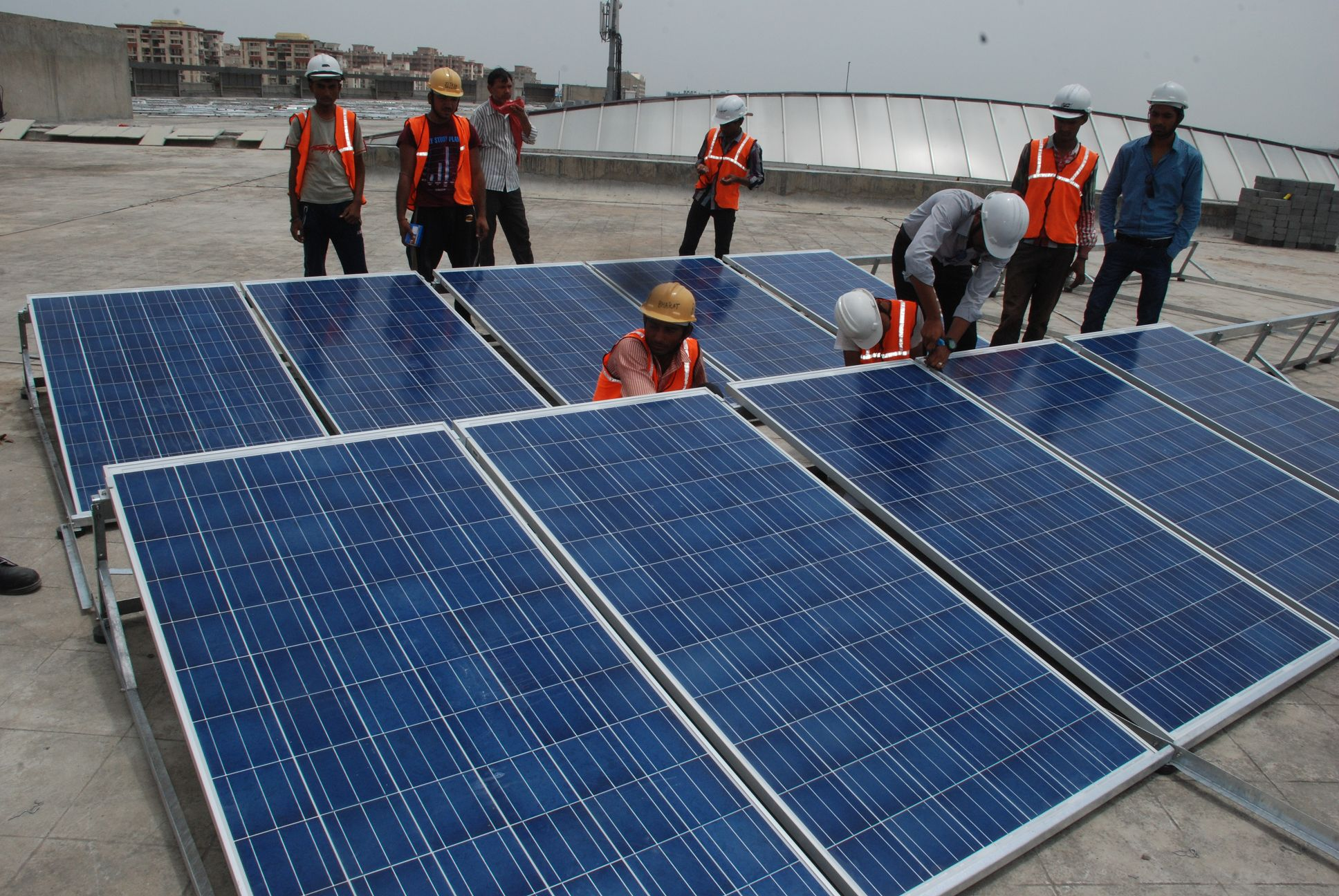 Workers in front of solar panels